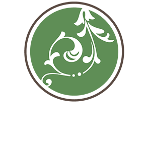 The don area logo, green circle with white floral pattern